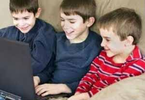 three boys on the computer