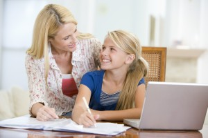 Parent going over a check-list of computer rules before child uses computer
