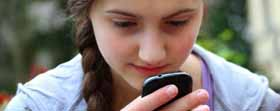 teen girl using apps on cellphone