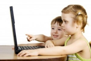 young children on computer devices
